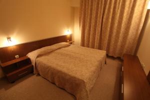 馬利納公寓酒店房間的床
