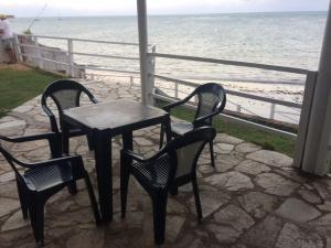 A balcony or terrace at Casa a Beira Mar Japaratinga