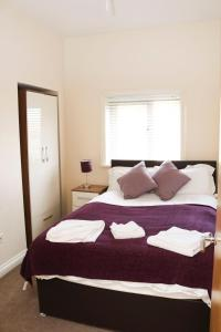 A bed or beds in a room at Parks Nest 5