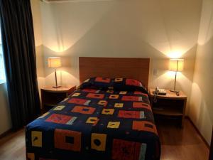 A bed or beds in a room at Hotel del Principado