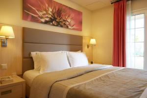 A bed or beds in a room at Mayor Capo Di Corfu