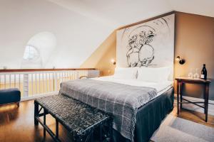 Säng eller sängar i ett rum på Stallmästaregården Hotel & Restaurant
