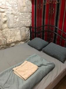 A bed or beds in a room at Chain Gate Hostel