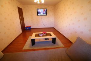 Гостиная зона в Apartment on Komendantskiy square 8