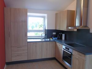A kitchen or kitchenette at Wein- Appartements Borth