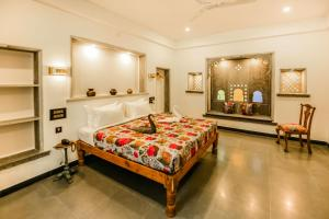 A bed or beds in a room at The Neem Tree