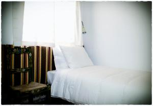 A bed or beds in a room at Casa Vitória Guest House