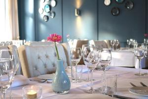 Een restaurant of ander eetgelegenheid bij Hotel Kasteel Doenrade