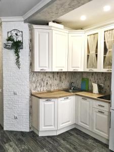 A kitchen or kitchenette at Alpiyskaya gorka
