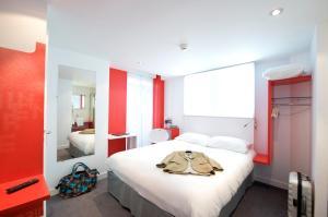 Un ou plusieurs lits dans un hébergement de l'établissement ibis Styles Vannes Gare Centre