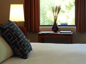A bed or beds in a room at George Kerferd Hotel