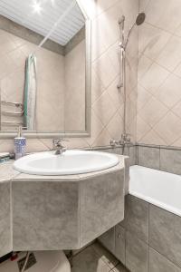Ванная комната в HomeBooking Apartments Tverskaya