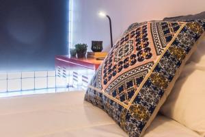 A bed or beds in a room at Casa das Monumentais