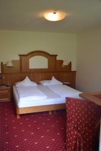Letto o letti in una camera di Hotel Scoiattolo