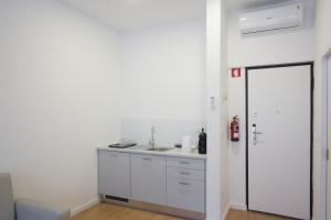 A cozinha ou kitchenette de Porto Bonjardim Apartments