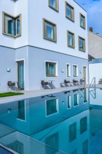 The swimming pool at or near Klinglhuber Suites