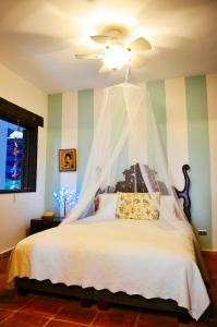 A bed or beds in a room at Magic Garden House