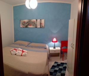 Letto o letti in una camera di Cialoma Home Holiday