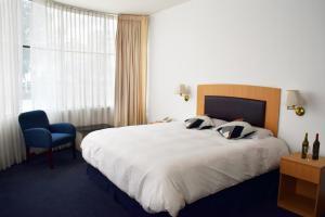 Кровать или кровати в номере Delfines Apart Hotel