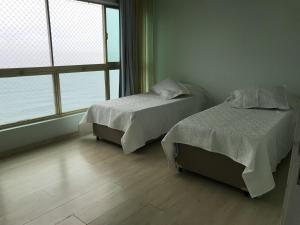 Cama ou camas em um quarto em Ilha Porchat