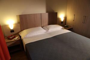 Letto o letti in una camera di Heraclea Hotel Residence