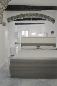 Letto o letti in una camera di Cà dei Ciuà - Apartments for rent
