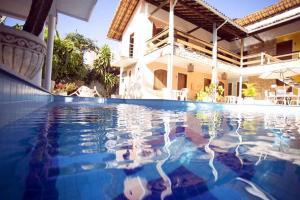 The swimming pool at or near Pousada Vitória