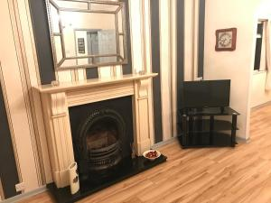 A television and/or entertainment center at Marcellas cottage