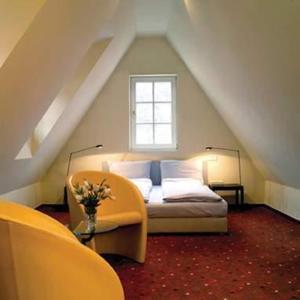 Ein Bett oder Betten in einem Zimmer der Unterkunft Hotel Ottheinrich