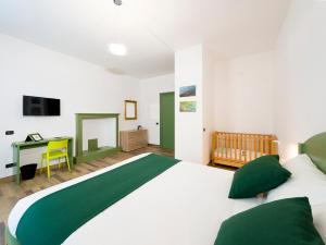A bed or beds in a room at La nostra casa in centro