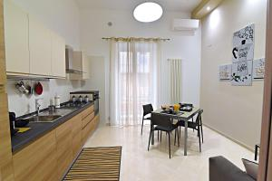 A kitchen or kitchenette at Gemini Suite