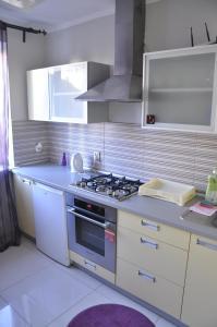Kuchnia lub aneks kuchenny w obiekcie Apartament Przy Ratuszu | The Very Center