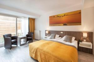 Un ou plusieurs lits dans un hébergement de l'établissement Hotel Victoria