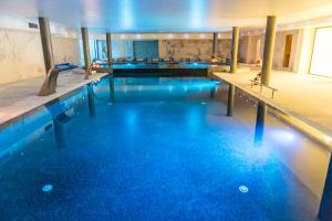 The swimming pool at or near Hotel Porta do Sol Conference & SPA