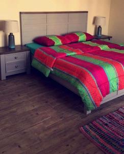 Cama ou camas em um quarto em Al Nakhlah Chalet