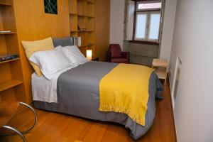 A bed or beds in a room at Civitá Design & Accommodation
