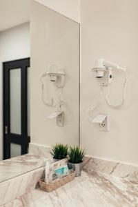 A bathroom at Chamberlain Boutique House - Silom