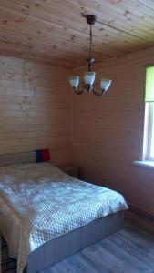 Кровать или кровати в номере Holiday home Berezovyi Hutor
