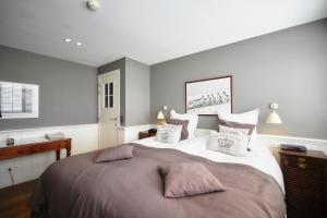 Un ou plusieurs lits dans un hébergement de l'établissement Romantik Manoir Carpe Diem