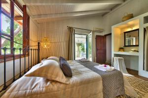 A bed or beds in a room at Glyfada Beach Villas