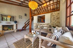 A seating area at Glyfada Beach Villas