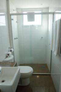A bathroom at Ímpar Suítes Expominas