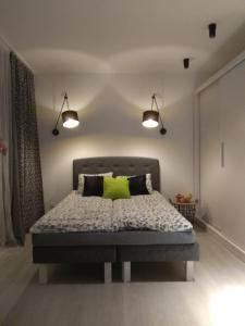 Łóżko lub łóżka w pokoju w obiekcie Apartament Nikola