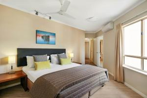 A bed or beds in a room at Mantra Amphora