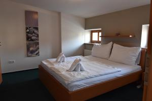 A bed or beds in a room at Pension U Jakuba