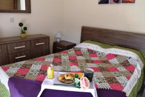 A bed or beds in a room at Zephyros Apartments