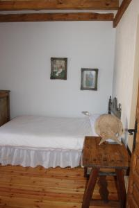 A bed or beds in a room at Exclusiva Casa Rustica