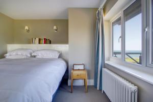 A bed or beds in a room at The Seaside Boarding House