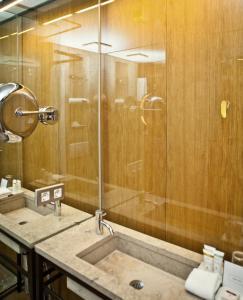 A bathroom at CORTIINA Hotel