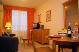 A television and/or entertainment center at Aparthotel Bahia Pinosol
